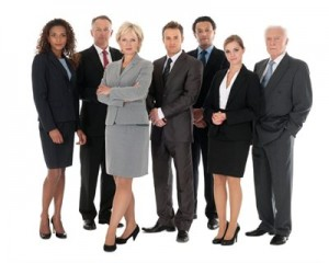 "A group of people dressed in ""business professional"" clothing."
